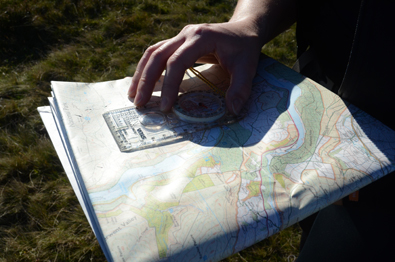 An Ordnance Survey map being used with a compass