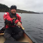 Mike Goude, owner of RockRiver Expeditions, canoeing on Loch Tay, Scotland