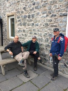 Mike, owner of RockRiver Expeditions with two clients at the Pen-y-Ghent cafe after completing the Yorkshire Three Peaks Challenge