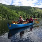 Gold Duke of Edinburgh Award participants from Craigholme School canoeing on Loch Ard, Scotland.