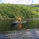 Andrew Hart from The Adventure Academy CIC canoeing on Loch Ard, Scotland