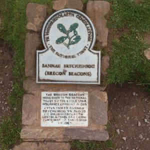 """Commemorative stone detailing how the Brecon Beacons were gifted to the National Trust. """"The Brecon Beacons were given to the National Trust by the Eagle Star Insurance Company in 1965. The text is then repeated in Welsh."""