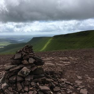 The cairn at Bwlch Duwynt and beyond, the green slopes of Craig Gwaun Taf