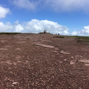 Looking up the broad stone path to the summit cairn of Pen-y-Fan