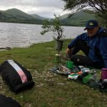 Mike Goude from RockRiver Expeditions lays out his wild camping kit on the shores of Inchconnachan Island on Loch Lomond