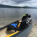 Canoe pulled up onto the beach at Luss on Loch Lomond
