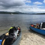 Canoes pulled up onto the beach at Luss on Loch Lomond