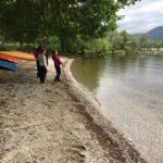Duke of Edinburgh award participants skimming stones on Loch Lomond