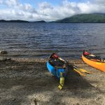 Two canoes ready to launch onto Loch Lomond from Sallochy Bay