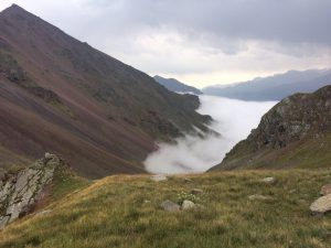 Valley filled with mist on descent walk to Cherget