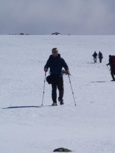 Michael Goude from RockRiver Expeditions descends a snowy Ben Nevis