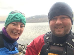 Michael and Paula Goude from RockRiver Expeditions wearing a woolly hat and a fleece hat on a canoe expedition in Scotland