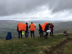 A Duke of Edinburgh group stand above Castleton looking down the valley