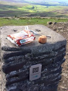 Pen y Ghent trig point with pork pies sat on top