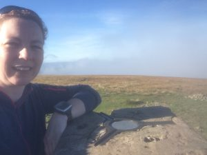 Paula Goude from RockRiver Expeditions at the trig point on Whernside