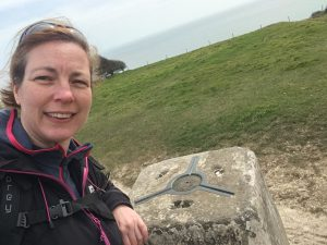 Paula Goude from RockRiver Expeditions at the trig point on Ballard Down