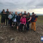 Snappy team celebrating the third and final summit of their Yorkshire Three Peaks Challenge with RockRiver Expeditions