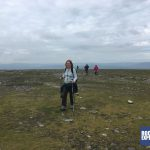 A Snappy fundraiser crosses the plateau of Ingleborough towards the end of her Yorkshire Three Peaks challenge with RockRiver Expeditions