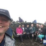 The Snappy Charity Yorkshire Three Peaks Challenge team enjoy a break on Whernside with their leader Michael Goude