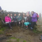 The Snappy Charity Yorkshire Three Peaks Challenge team enjoy a break on Whernside despite the rain