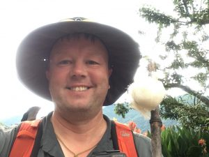 Michael Goude of RockRiver Expeditions with a salt bag on a stick in Nepal